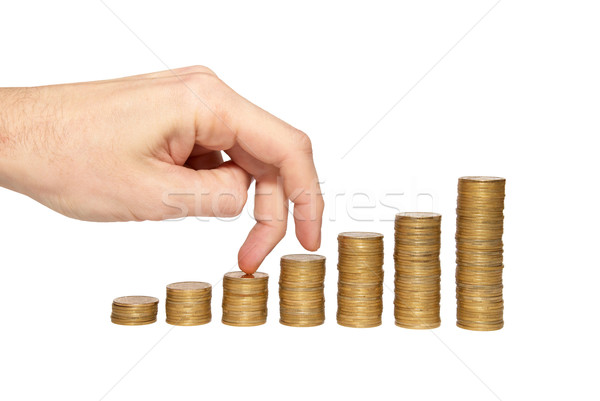 Klimmen hand gouden munt trappenhuis geïsoleerd witte Stockfoto © vapi