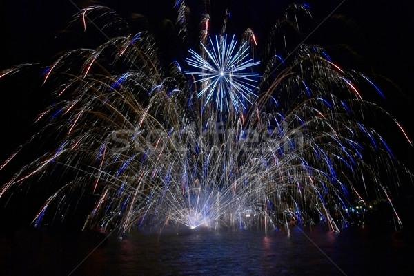 Színes tűzijáték kék fekete égbolt ünnep Stock fotó © vapi