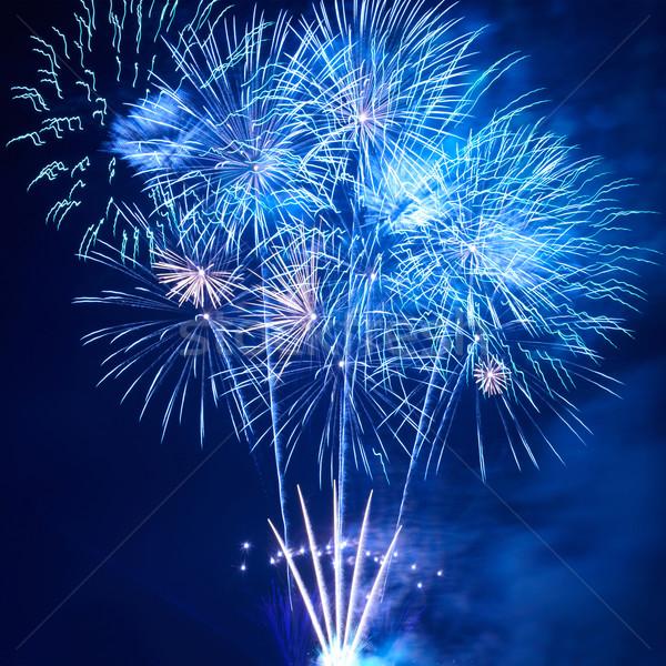 Kék színes tűzijáték fekete égbolt boldog Stock fotó © vapi