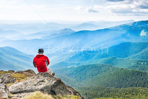 Young man meditates on the top Stock photo © vapi
