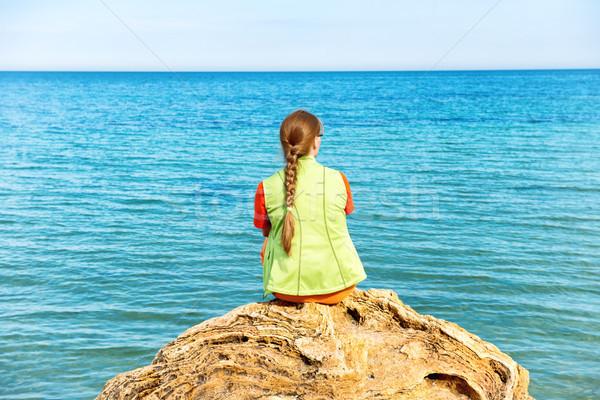 Young woman sitting on a big rock Stock photo © vapi