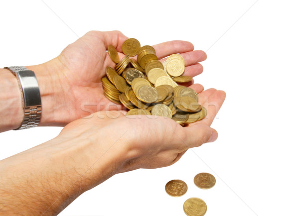 Many coins in cupped hands isolated on white. Stock photo © vapi