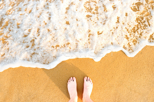 Láb citromsárga tengerparti homok tenger hullám fehér Stock fotó © vapi