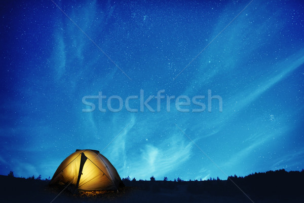 Stock photo: Illuminated camping tent at night