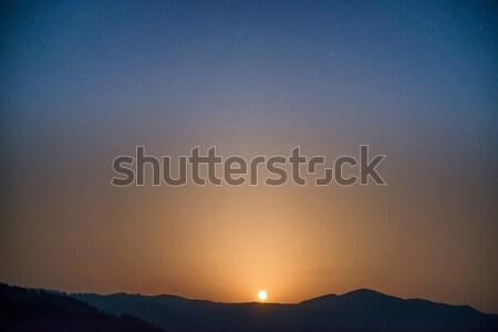 Moon rising on night sky Stock photo © vapi