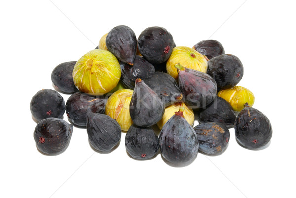 Stack of black and yellow figs isolated on white. Stock photo © vapi