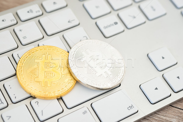 Golden and silver bitcoins on a keyboard Stock photo © vapi