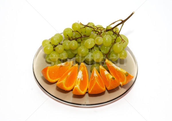 Green grapes and orange isolated on white. Stock photo © vapi