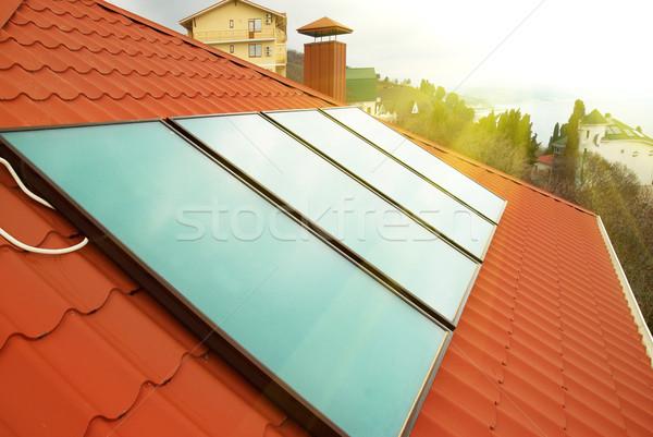 Güneş su ısıtma kırmızı ev çatı Stok fotoğraf © vapi