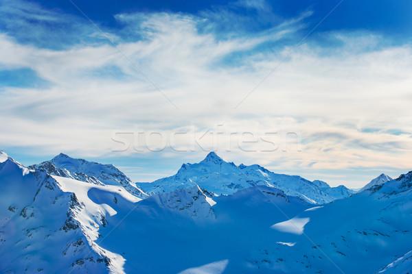 Kék hegyek felhők tél sí üdülőhely Stock fotó © vapi