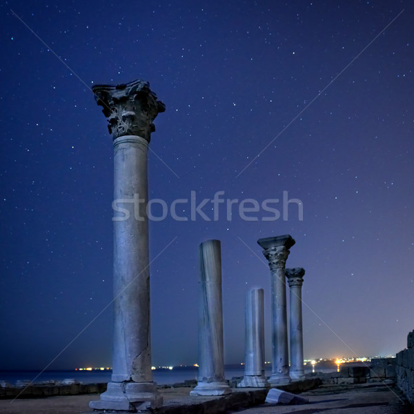 Ruins of ancient city columns under night sky Stock photo © vapi