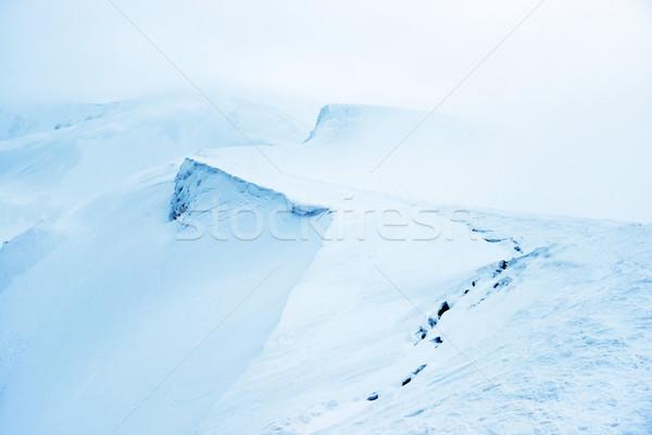 Hegy hó köd kék tél tájkép Stock fotó © vapi