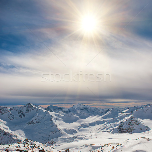 Snowy blue mountains in clouds Stock photo © vapi