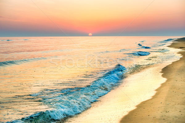 Sunset on the beach with long coastline Stock photo © vapi