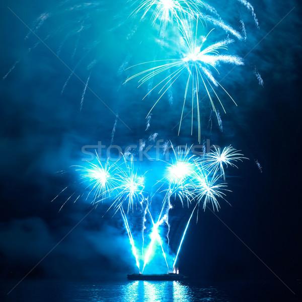 Színes ünnep tűzijáték kék fekete égbolt Stock fotó © vapi