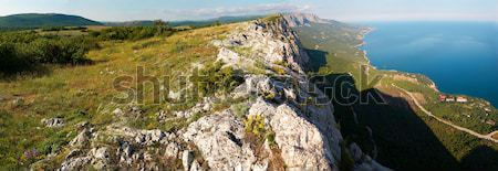 View from the top of the mountain to the steep. Wide-angle panor Stock photo © vapi
