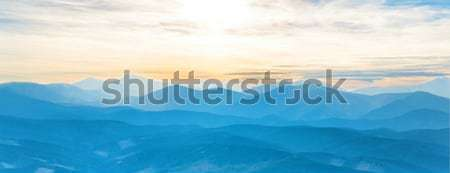 Blue mountains at sunset sky Stock photo © vapi