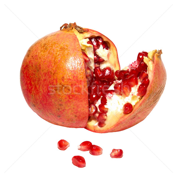 Red pomegranate with grains isolated on white. Stock photo © vapi