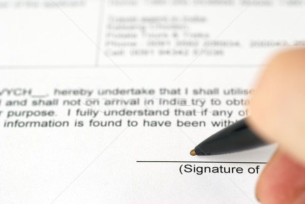 Businessman's hand with pen signing contract Stock photo © vapi