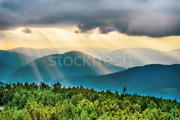 Sunset over blue mountains Stock photo © vapi