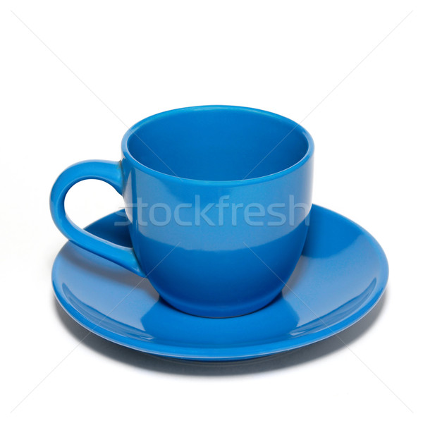 Blue ceramic cup and saucer isolated on white. Stock photo © vapi