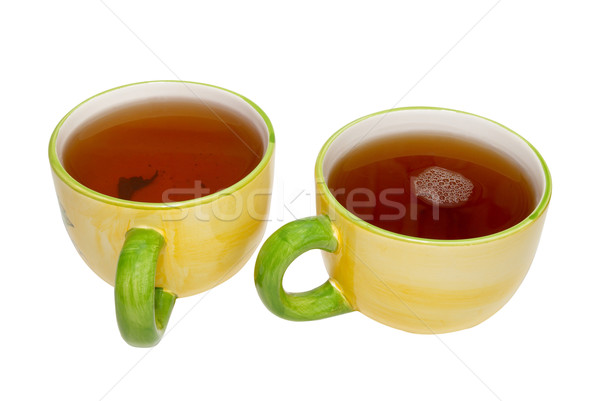 Two teacups with tea isolated on white. Stock photo © vapi