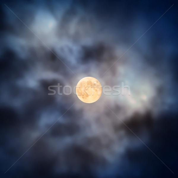 Night view at full moon through moving clouds Stock photo © vapi