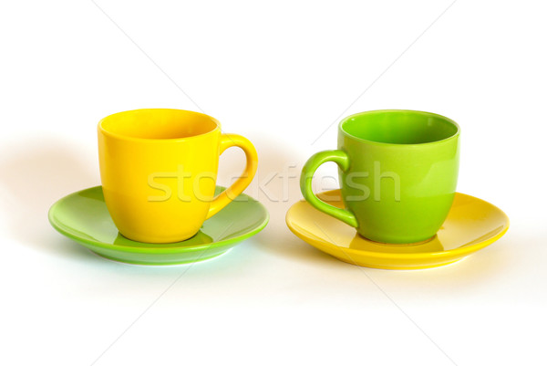 Two colored tea cups and saucers on white background. Stock photo © vapi