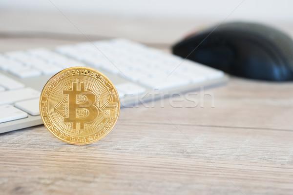Golden bitcoin on a wooden desk Stock photo © vapi