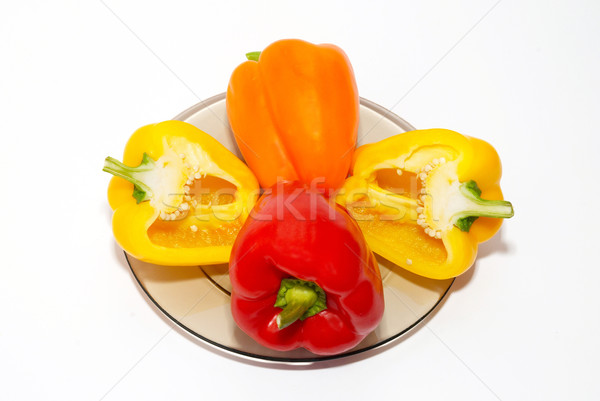 Three colored paprika on the plate on white background. Stock photo © vapi