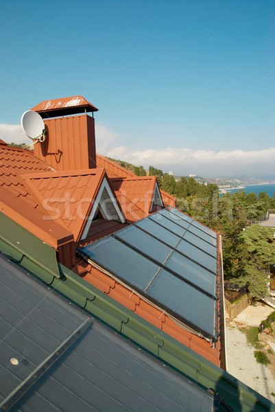 Stock photo: Alternative energy- solar system on the house roof.