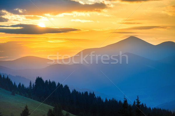 Bergen zonsondergang landschap zon wolken Stockfoto © vapi