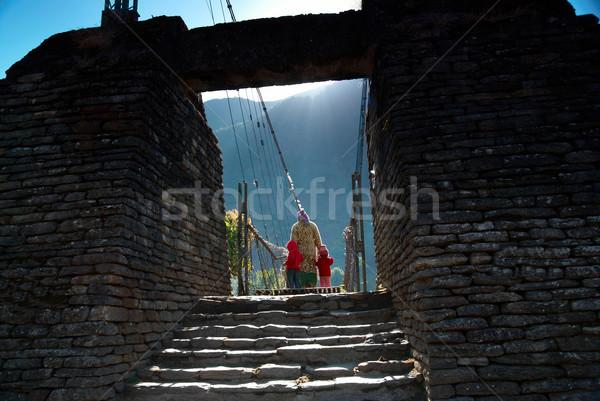 Gate to the bridge with silhouettes Stock photo © vapi