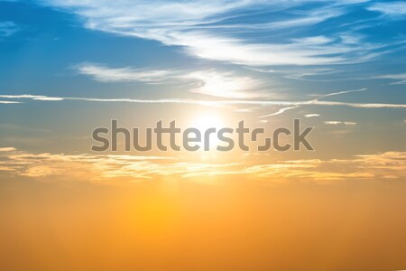Sunset in the sky with blue orange clouds Stock photo © vapi