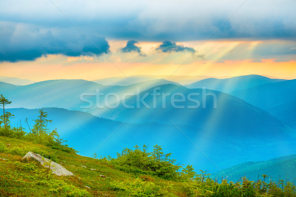 Sunset over blue mountains Stock photo © vapi