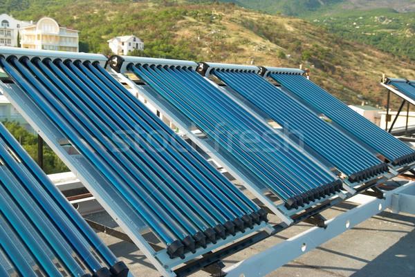 Vácuo solar água aquecimento casa telhado Foto stock © vapi