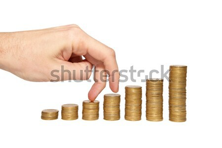 Climbing hand on gold coin staircase isolated on white. Stock photo © vapi
