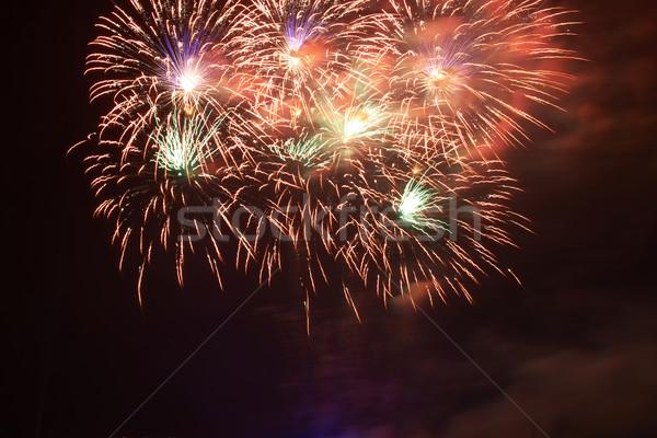 Coloré feux d'artifice rouge noir ciel heureux Photo stock © vapi