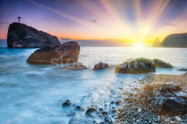 Pôr do sol praia mar rochas dramático céu Foto stock © vapi