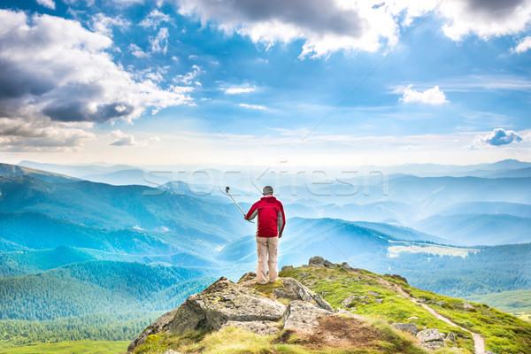 Young man on mountain taking selfie Stock photo © vapi