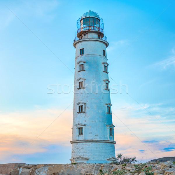 Faro mare costa tramonto cielo spiaggia Foto d'archivio © vapi