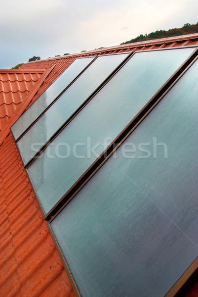 Zonnepaneel huis dak business water zon Stockfoto © vapi
