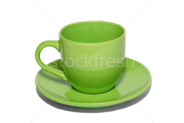 Green ceramic cup and saucer isolated on white. Stock photo © vapi
