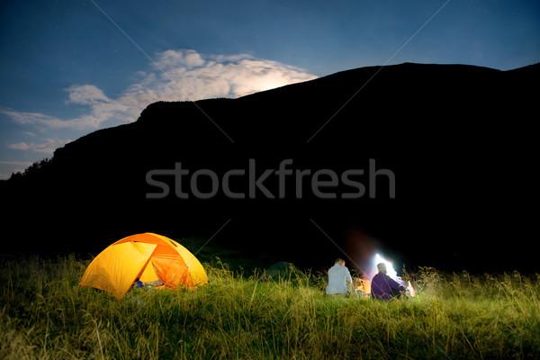 Mensen verlicht oranje tent camping nacht Stockfoto © vapi