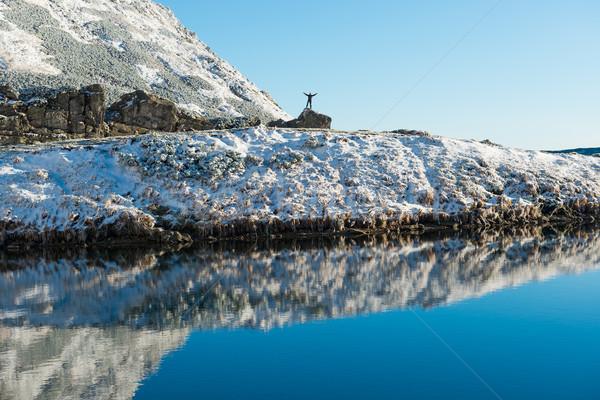Stok fotoğraf: Adam · kaya · arkasında · mavi · göl · başarılı