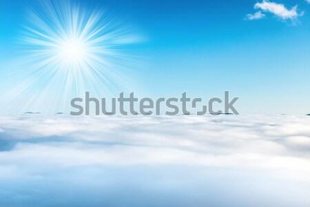 Sol céu nuvens blue sky oceano pôr do sol Foto stock © vapi