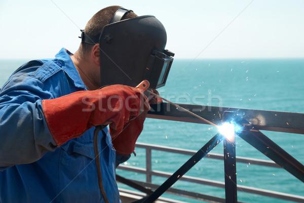 Hegesztő dolgozik fém építkezés gyár tűz Stock fotó © vapi