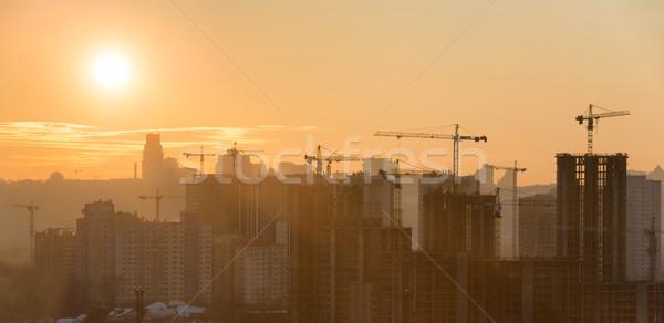 Panoráma naplemente város sziluett épületek ipari Stock fotó © vapi