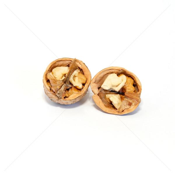 Two halves of walnut isolated on white. Stock photo © vapi