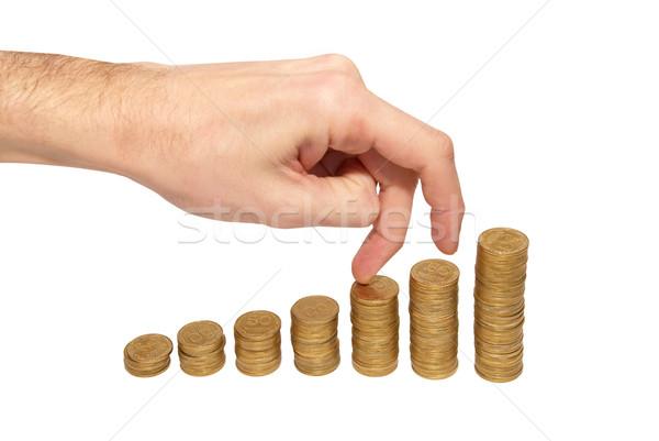 Climbing hand on gold coin staircase Stock photo © vapi